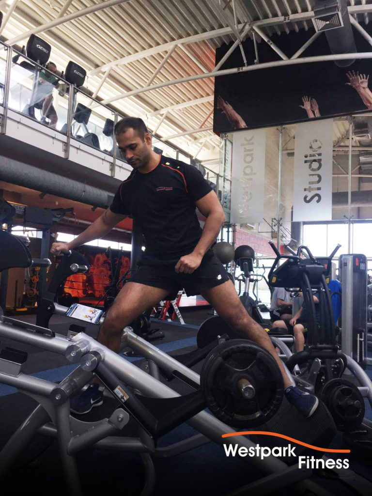 repetitive strain injury westpark fitness blog image of male gym goer standing on a piece of gym equipment on the gym floor