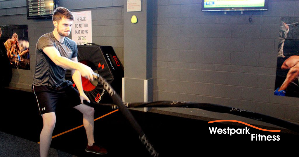 battle ropes westpark fitness trainer using them on the gym floor