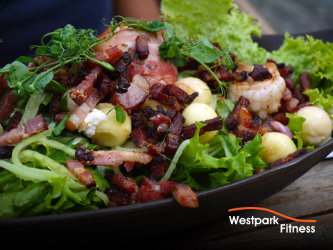blt in a bowl bacon lettuce and tomato served together in a black bowl