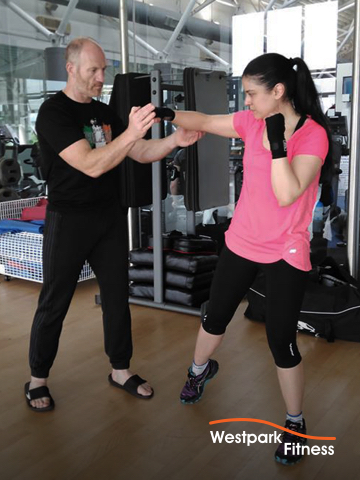 cardio kickboxing at westpark fitness male and female gym goers practicing sparring moves