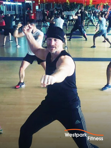cardio kickboxing at westpark fitness class held in gym studio with wooden floor and mirrored walls