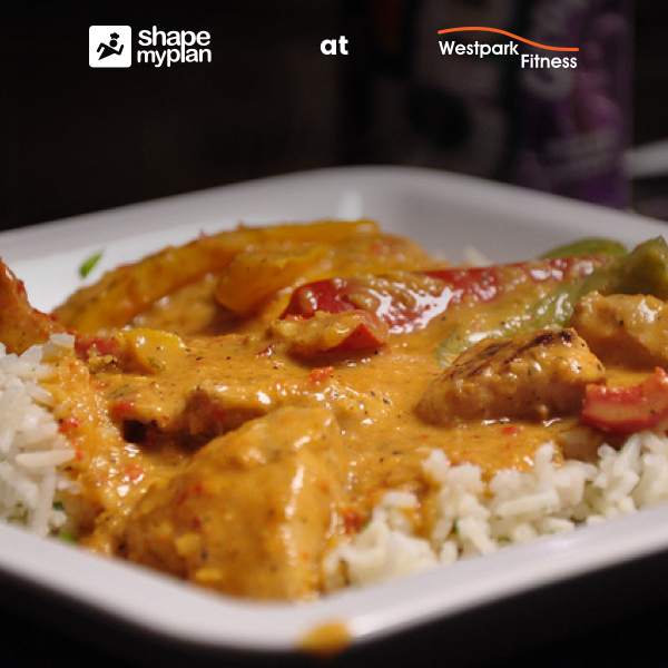 westpark fitness chicken satay curry chicken and vegetables in a satay sauce on white rice on a white plate