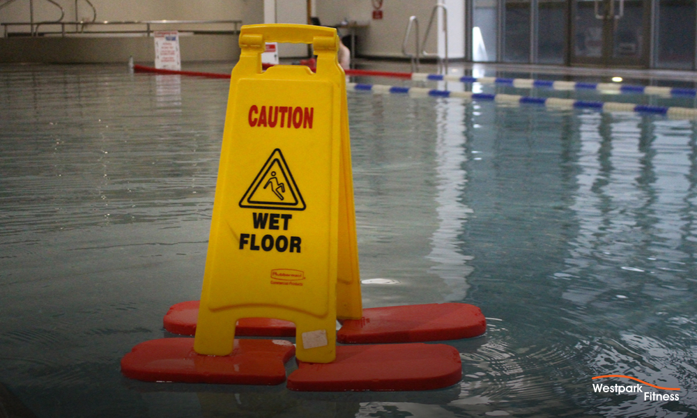 swimming lessons in tallaght dublin 24 westpark fitness swimming pool with yellow wet floot sign floating on foam pads on top of the swimming pool water