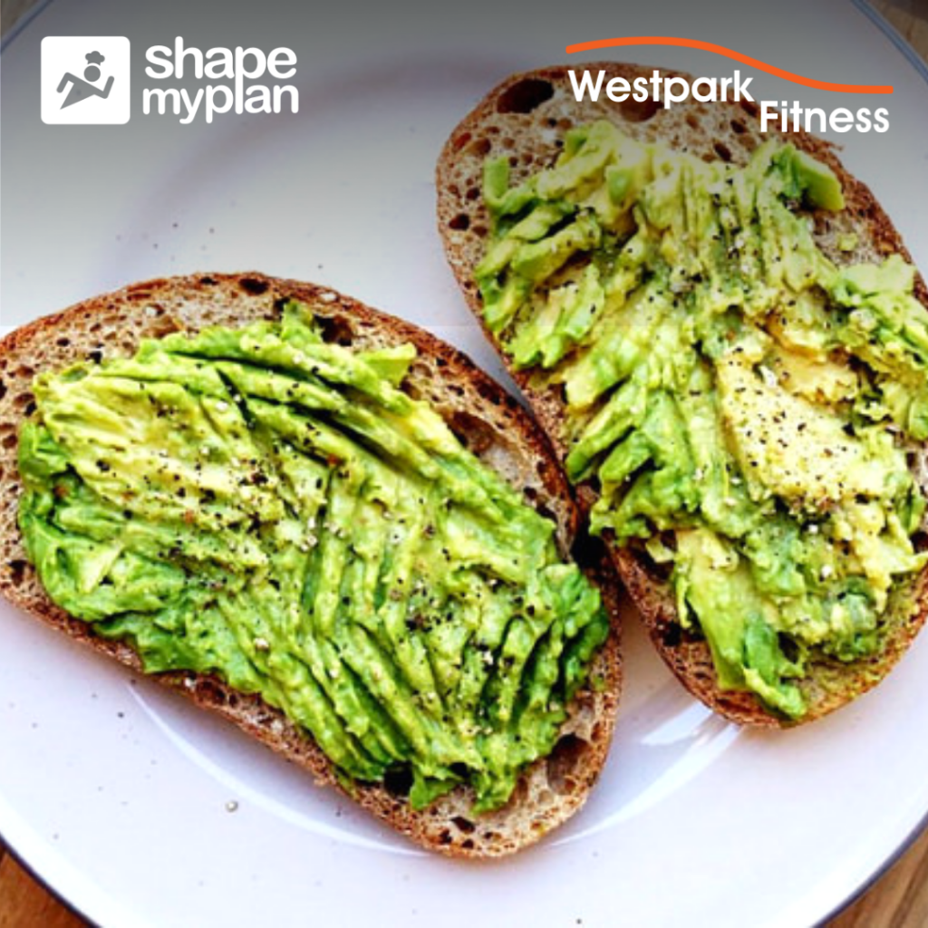 avocado toast recipe at westpark fitness two pieces of bread covered in mashed avocado on a white plate