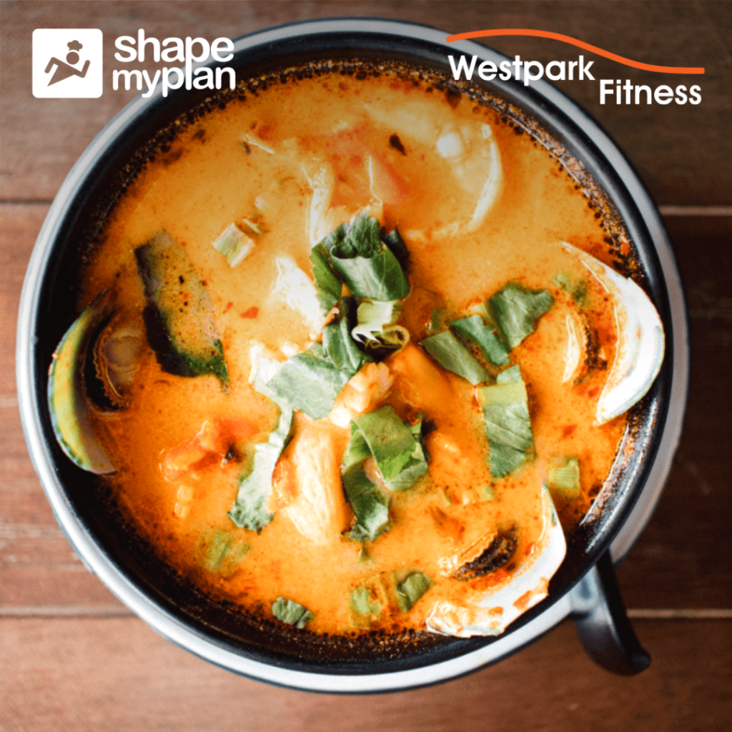creamy prawns on a round plate filled with orange coloured sauce and vegetable slices at westpark fitness
