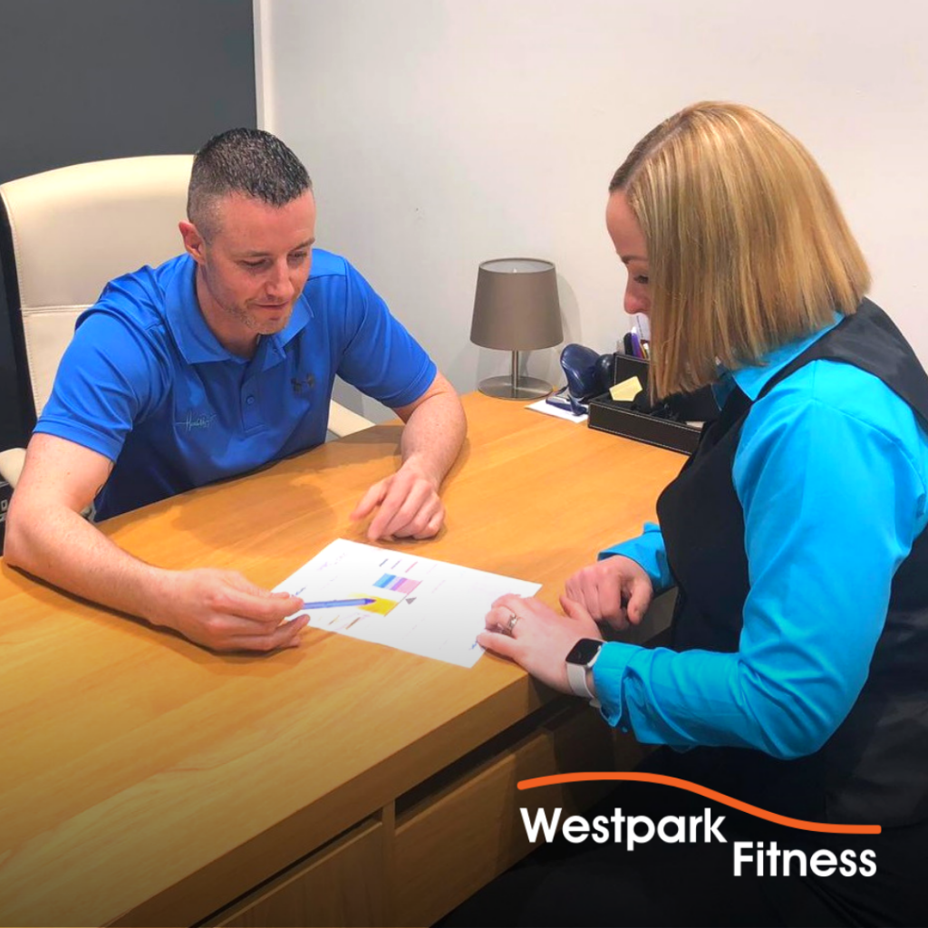 metabolic testing in dublin 24 at westpark fitness with health matters man and woman sitting opposite each other at a desk both looking at a sheet of paper