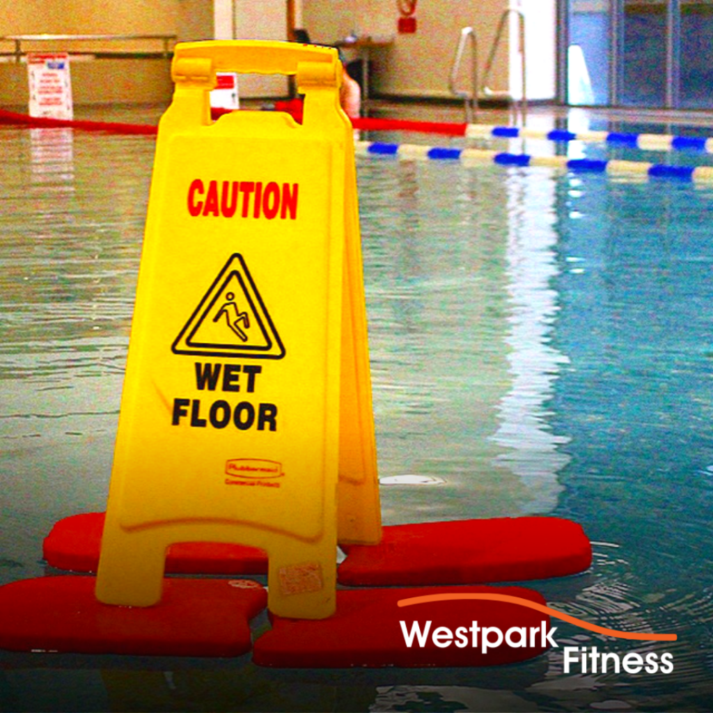 swimming in dublin 24 westpark fitness image of wet floor sign floating on four foam blocks on the water of the swimming pool